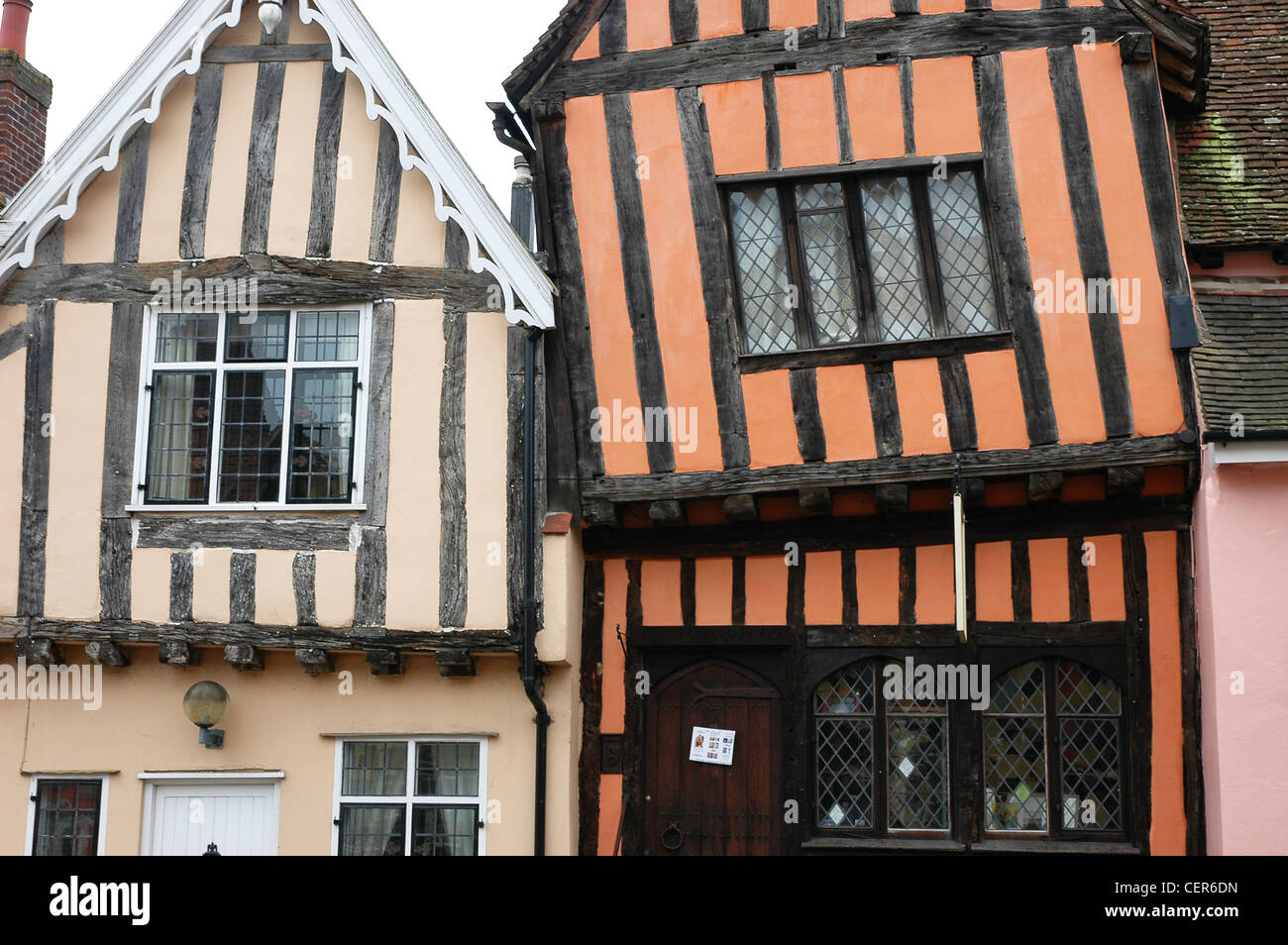 The Tudor facia of a terrace of houses in the Suffolk village of Lavenham. - Stock Image