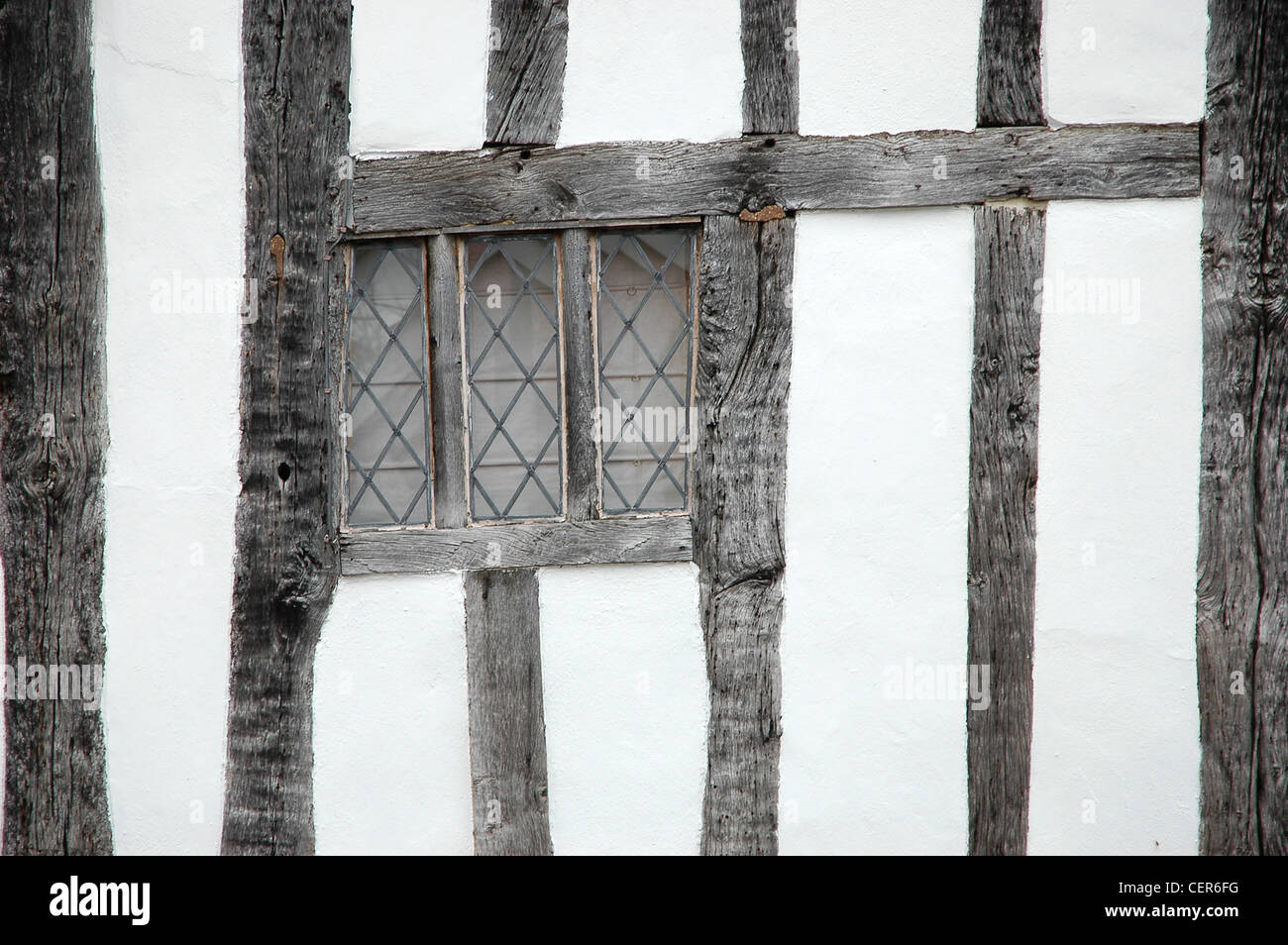 The Tudor beamed facia of a house in the Suffolk village of Lavenham. - Stock Image