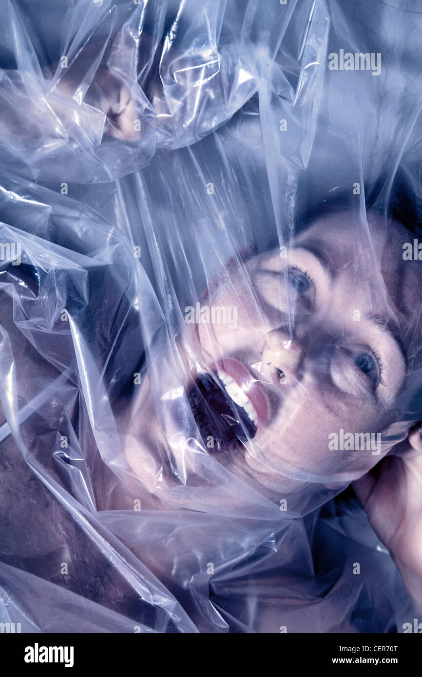 Woman under plastic covering Stock Photo