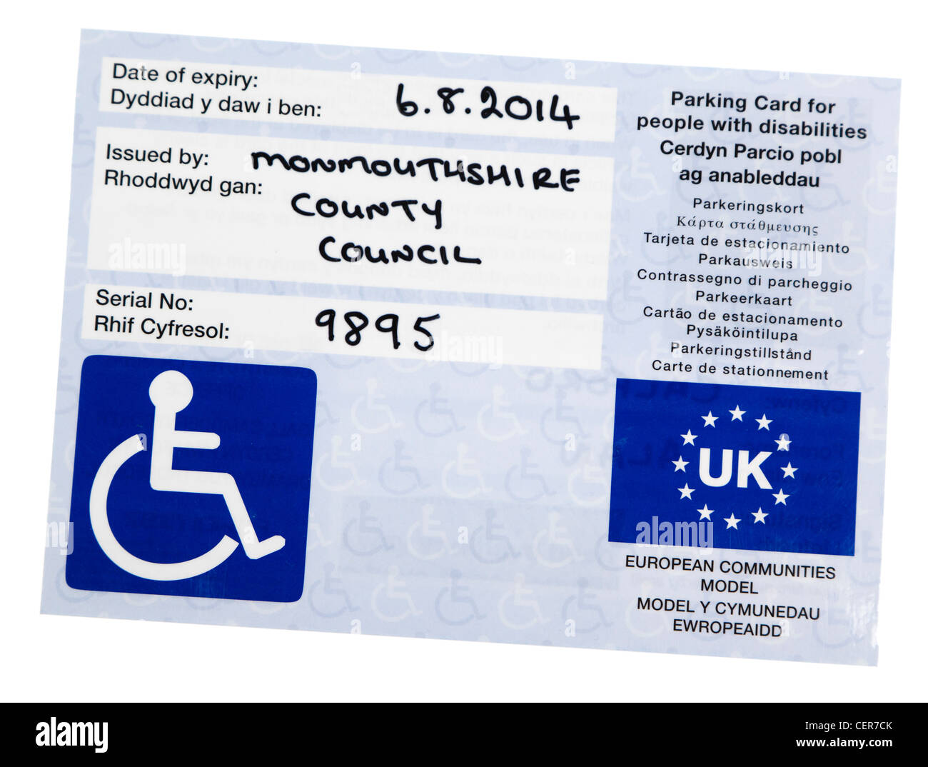 Example pf blue badge issued for parking permission for people with disabilities, UK - Stock Image
