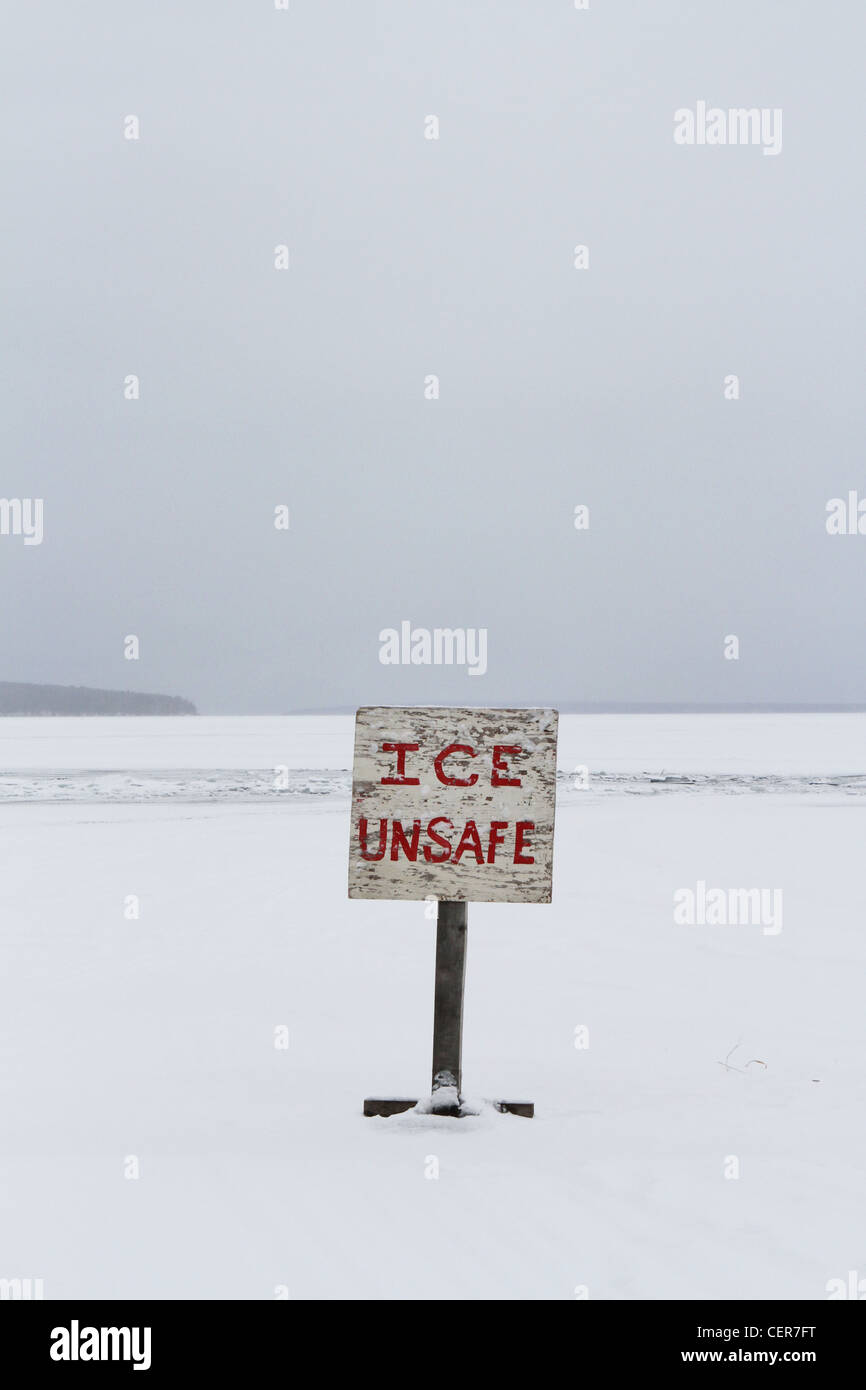 A handmade sign that reads 'ice unsafe'. - Stock Image