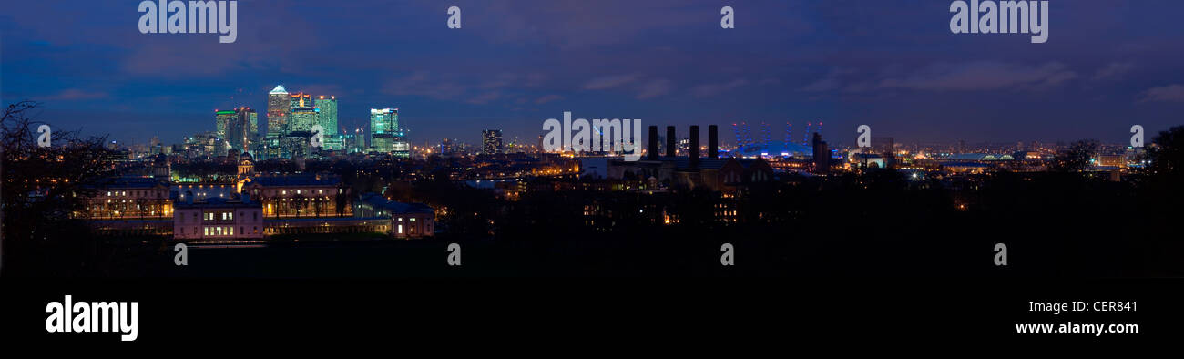 Panoramic view of the London Docklands skyline at night from Greenwich. - Stock Image