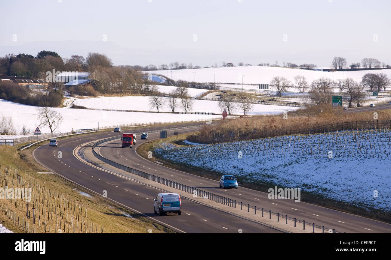 The A4146 dual carriageway surrounded by snow between Old Linslade and Soulbury. Stock Photo