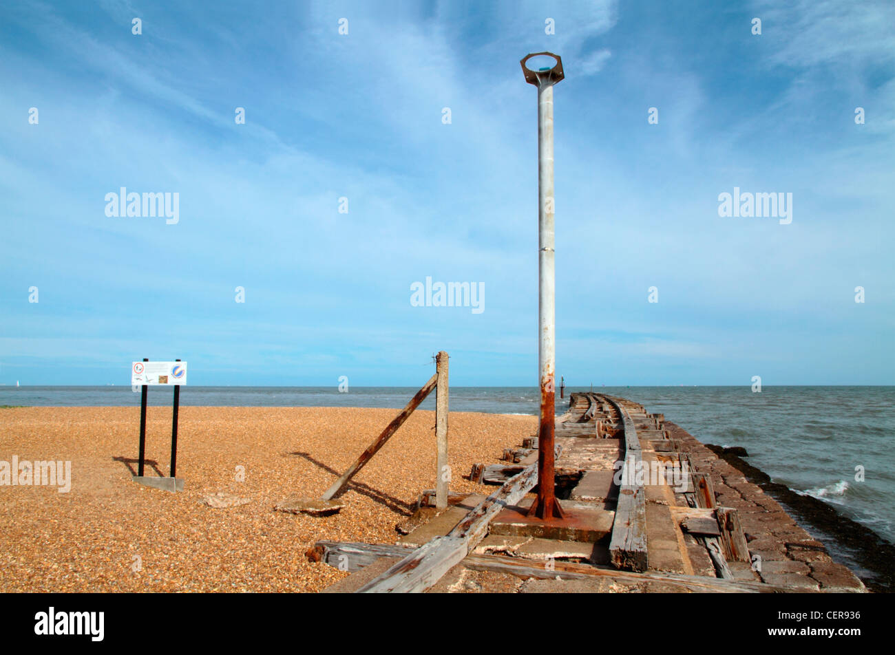 The remains of an old rail jetty at Landguard Point, the most southerly part of Suffolk. - Stock Image