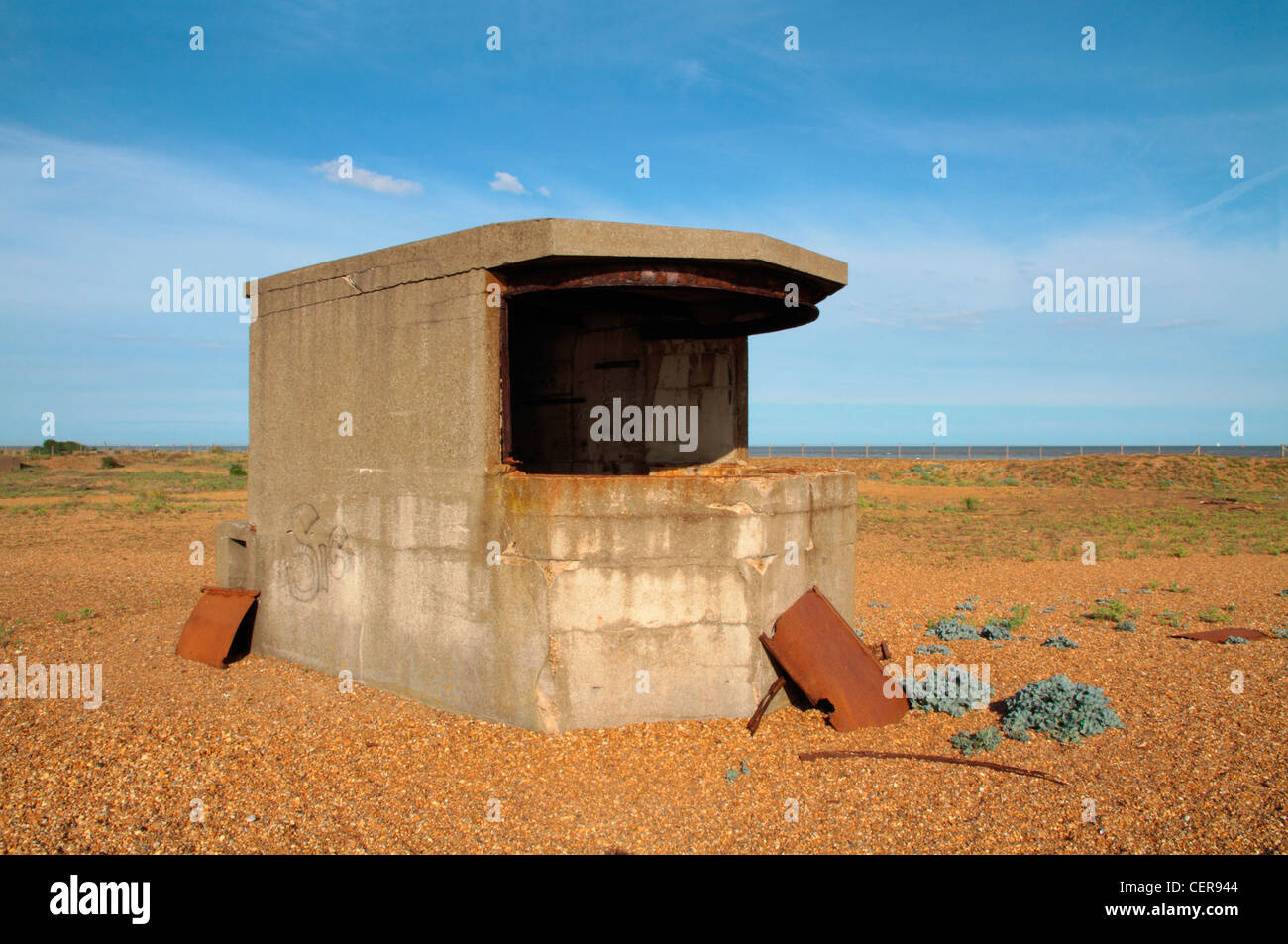A derelict world war two pillbox on the beach at Landguard Point, the most southerly part of Suffolk. - Stock Image