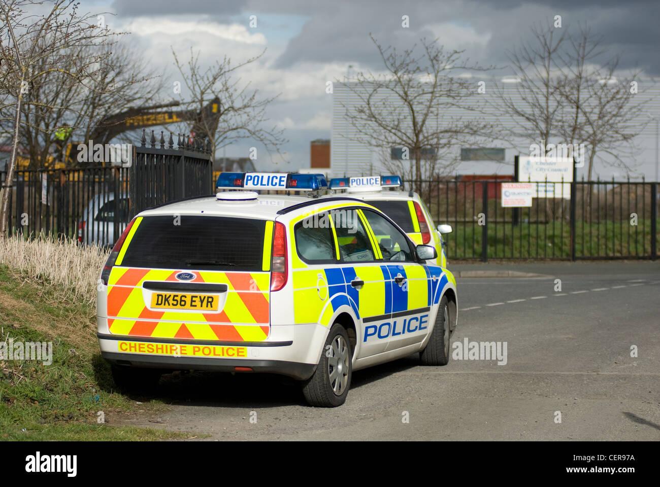 Uk police car at the scene of a civil disturbance - Stock Image