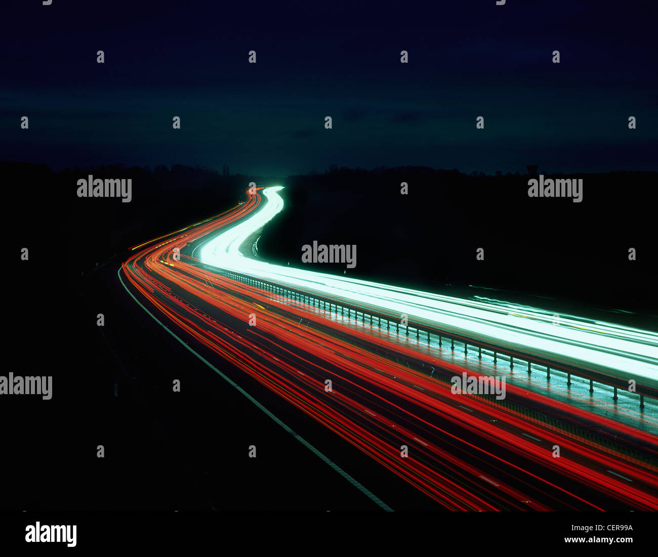 Light trails from traffic on the M11 motorway at night. - Stock Image