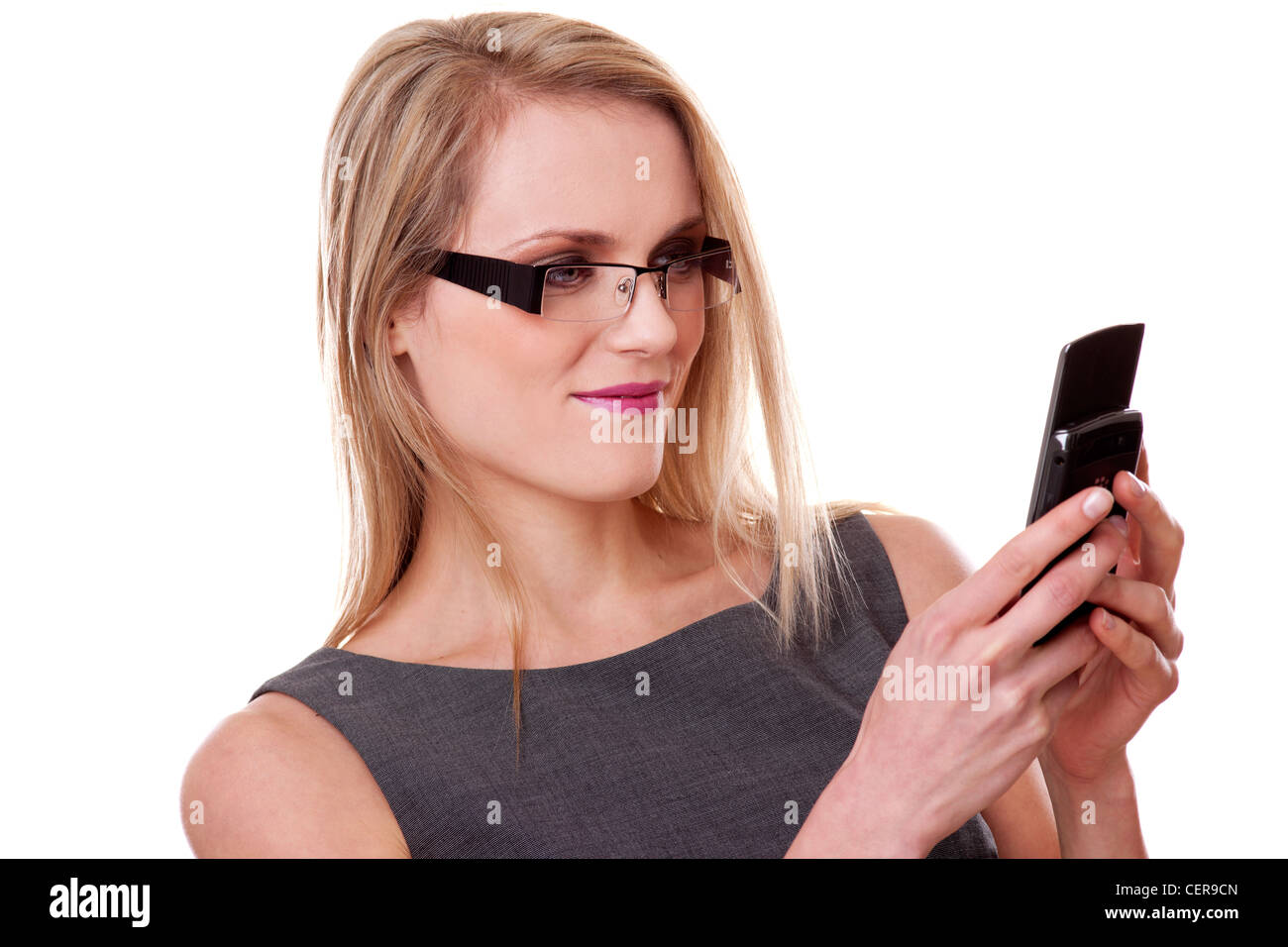 blonde woman sending a text message or email - Stock Image