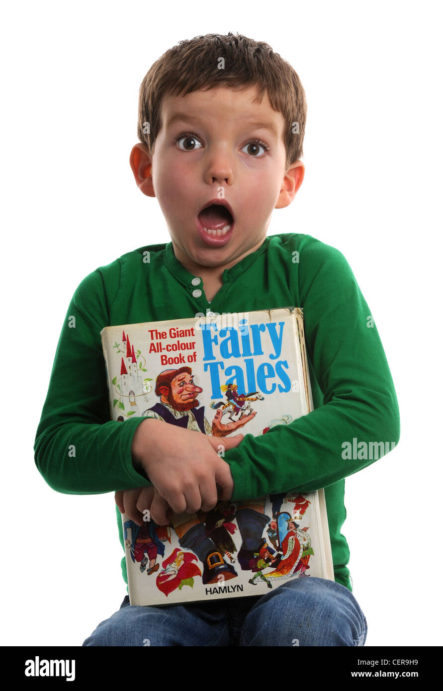 Boy with a book of Fairy Tales - Stock Image