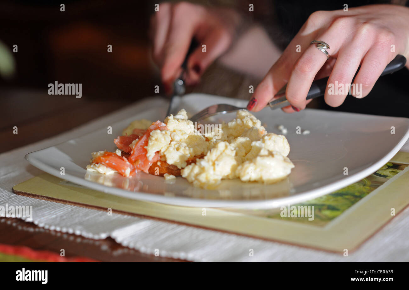 Scrambled eggs and smoked salmon for breakfast - Stock Image