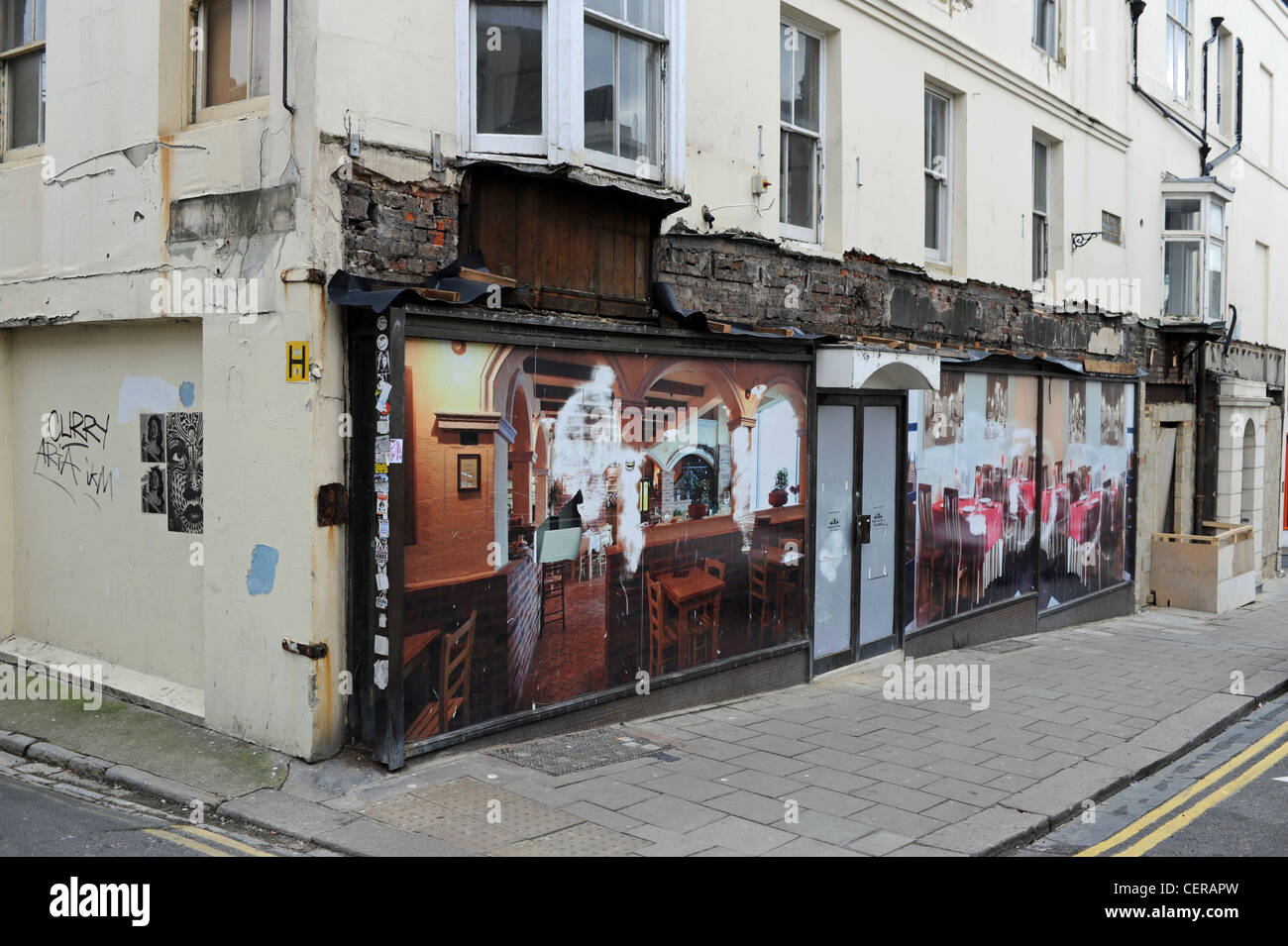 Run down and closed down restaurant premises in Preston Street Brighton UK during the recession 2012 - Stock Image
