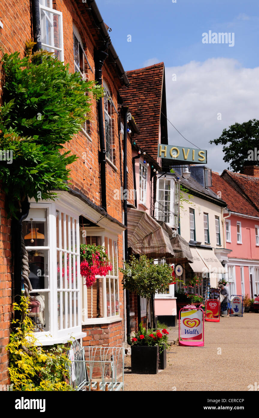 A row of shops on the Market Square in the historic town of Lavenham. - Stock Image