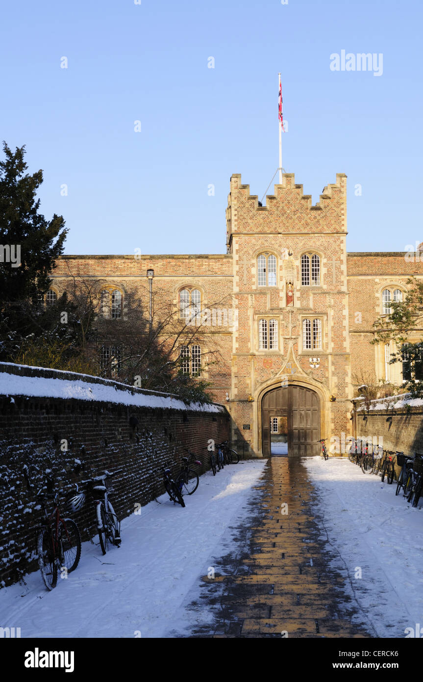 Snow covering the path leading to Jesus College Gatehouse in winter. Stock Photo