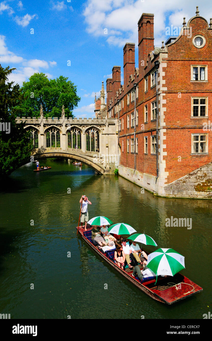 Tourists enjoying a trip along the River Cam by the Bridge of Sighs in a punt at St Johns College. Stock Photo