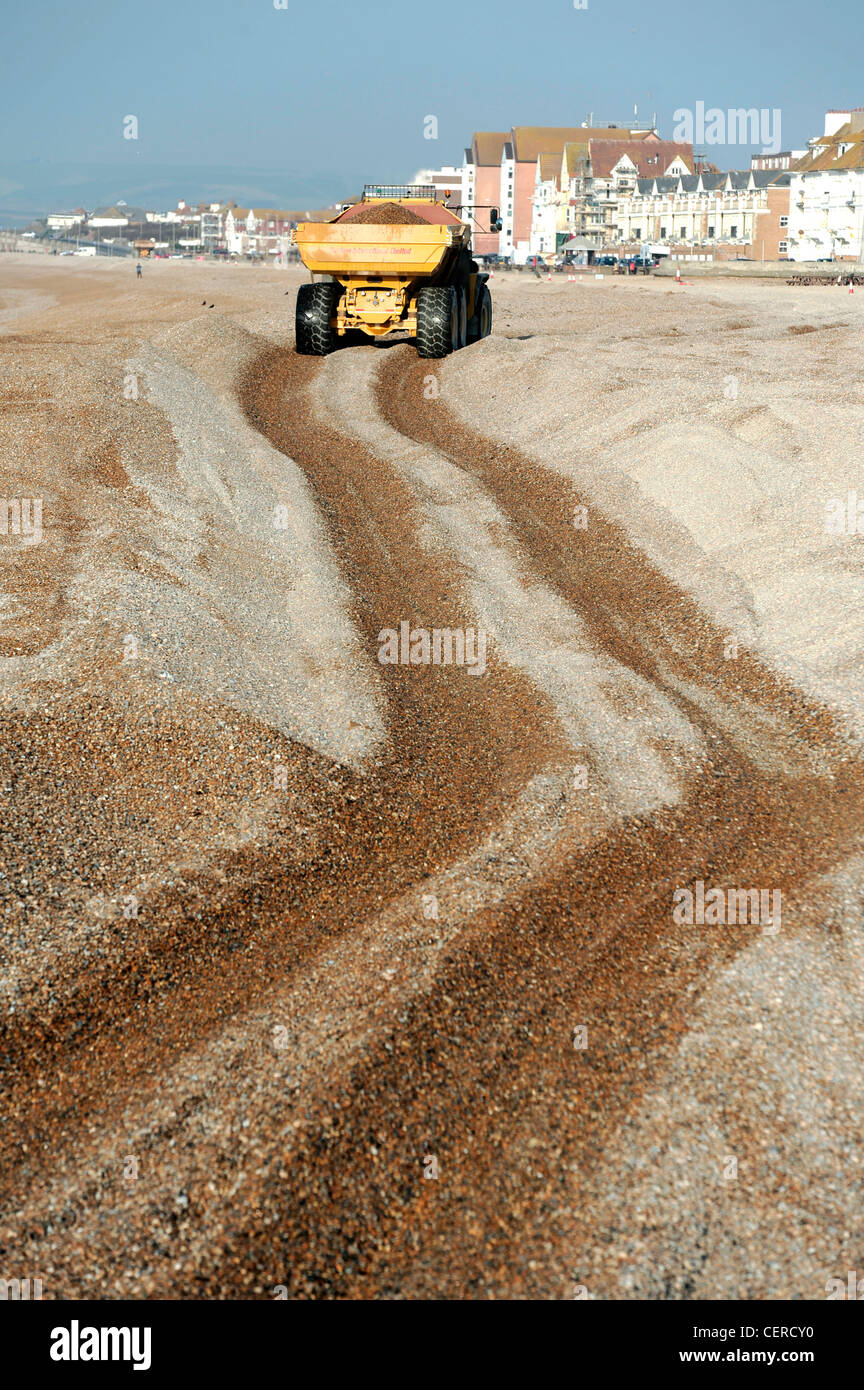 Rebuilding shingle beaches after winter storms, Seaford, East Sussex. - Stock Image