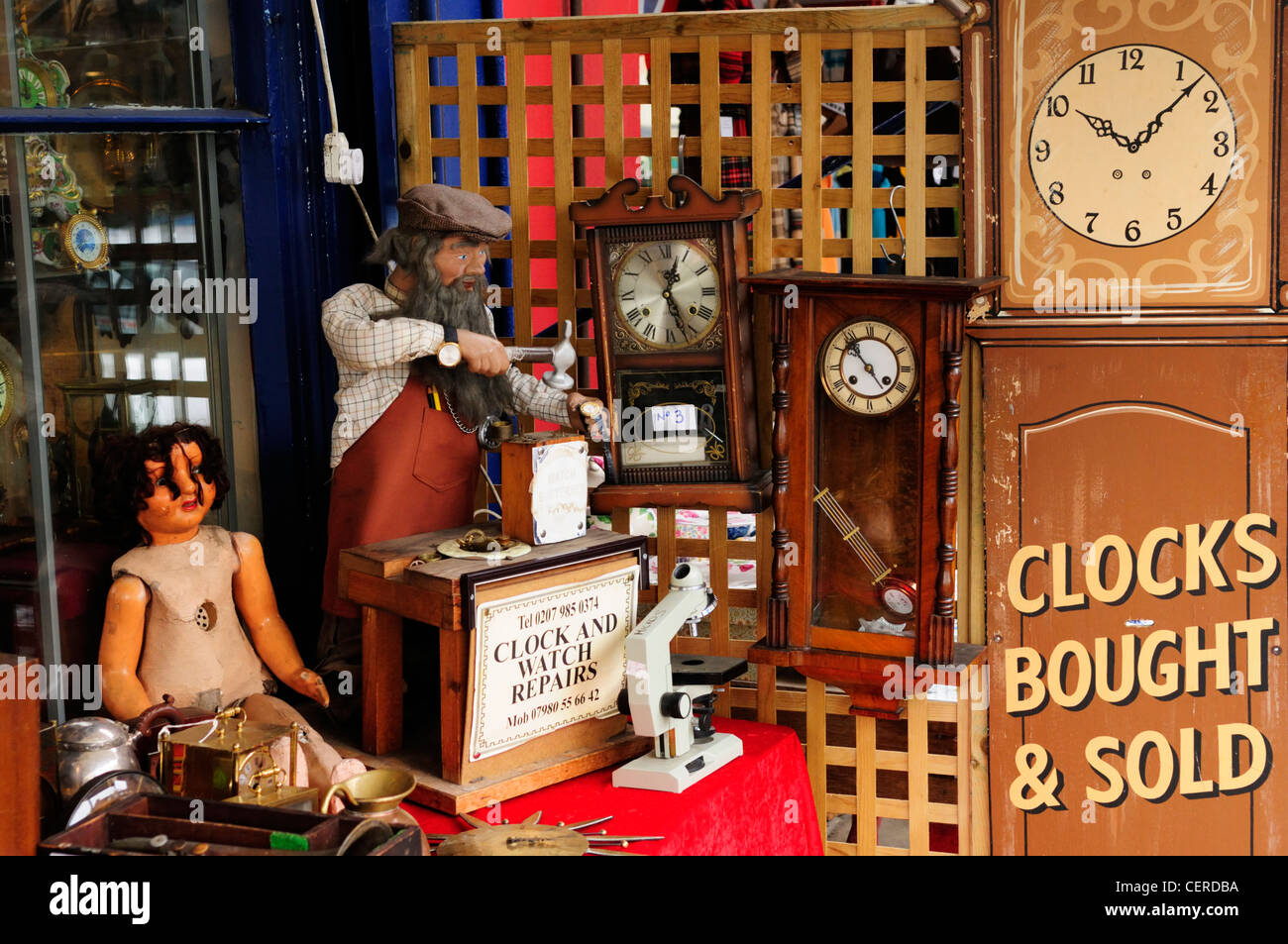 The window display of a Clock and Watch Repairs shop on Portobello Road. - Stock Image
