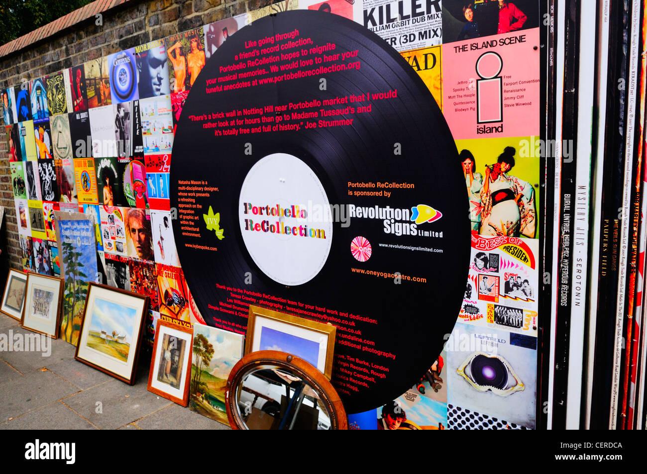 Portobello ReCollection wall decorated as classic vinyl record album covers in Portobello Road. - Stock Image