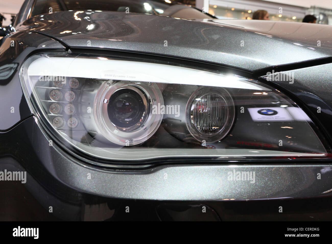 bmw car headlight closeup - Stock Image