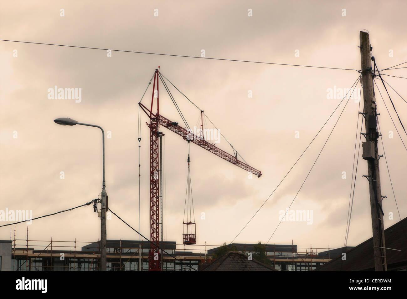 Crane on building site near Cork,County Cork, Republic of Ireland. - Stock Image