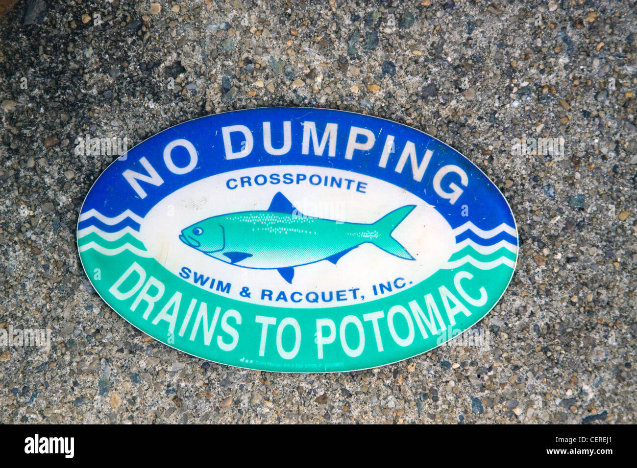Fairfax County Virginia No Dumping Drains to Potomac sign on top of a storm water drainage catch basin inlet structure - Stock Image