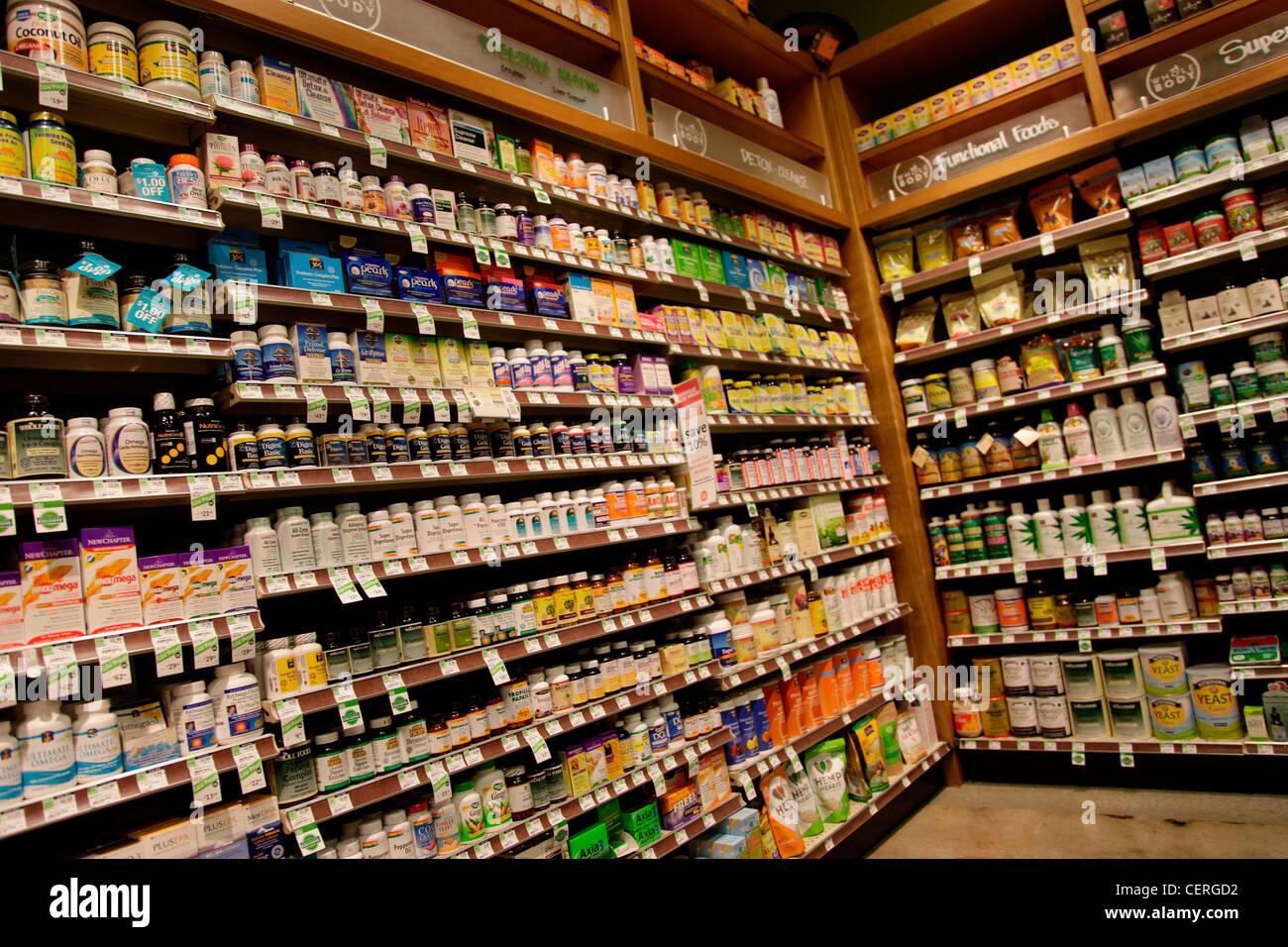 VITAMINS ON SALE IN USA SUPERMARKET - Stock Image