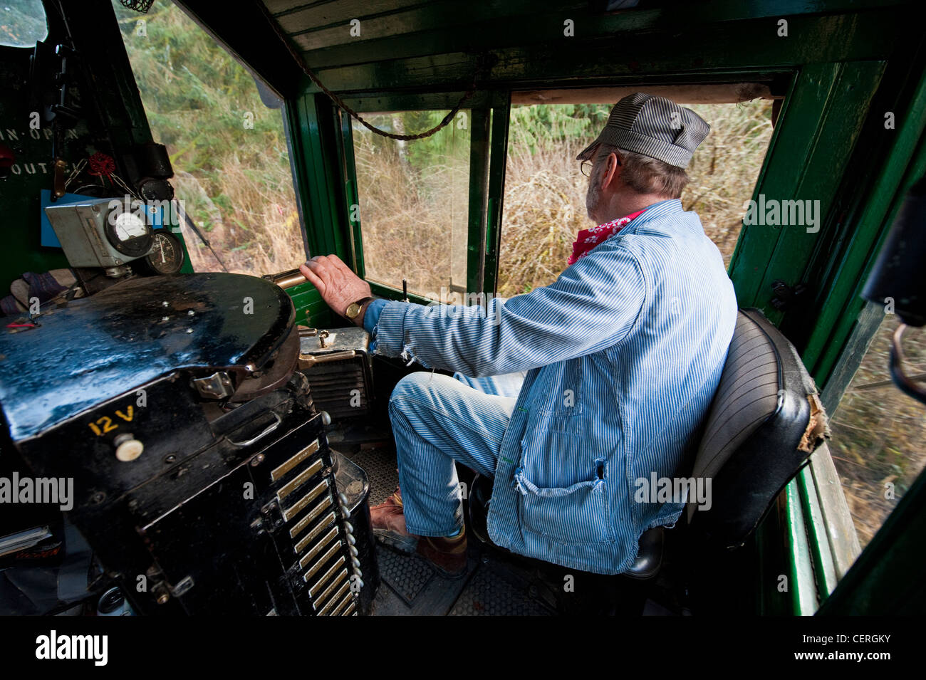 a train engineer driving an antique diesel locomotive on the lake whatcom railway route in northwest washington state