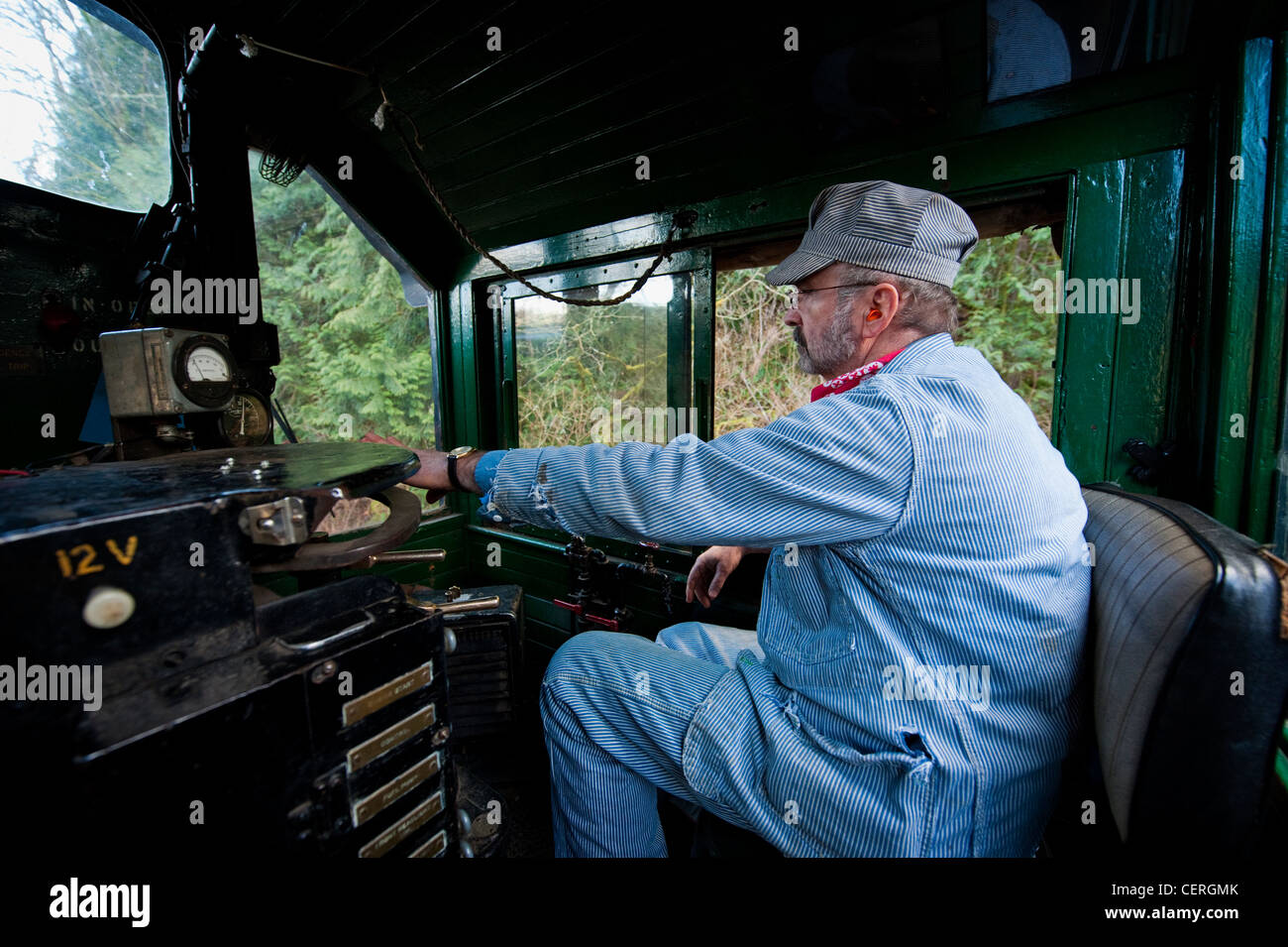 A train engineer driving an antique diesel locomotive on the Lake Whatcom Railway route in northwest Washington - Stock Image