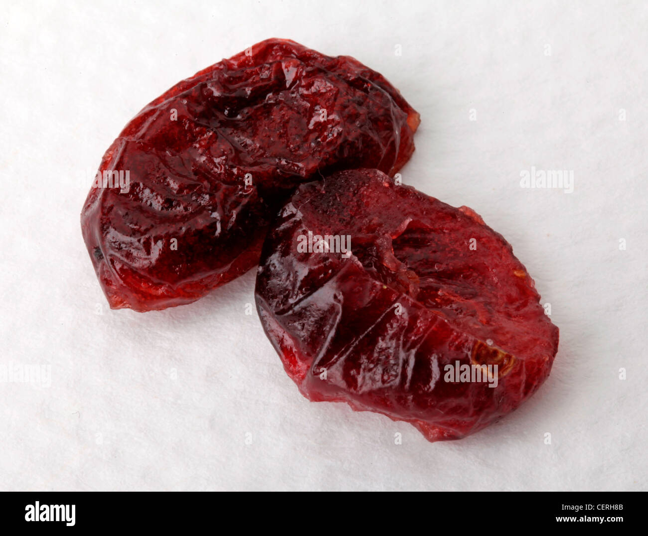 TWO DRIED CRANBERRIES ON WHITE - Stock Image
