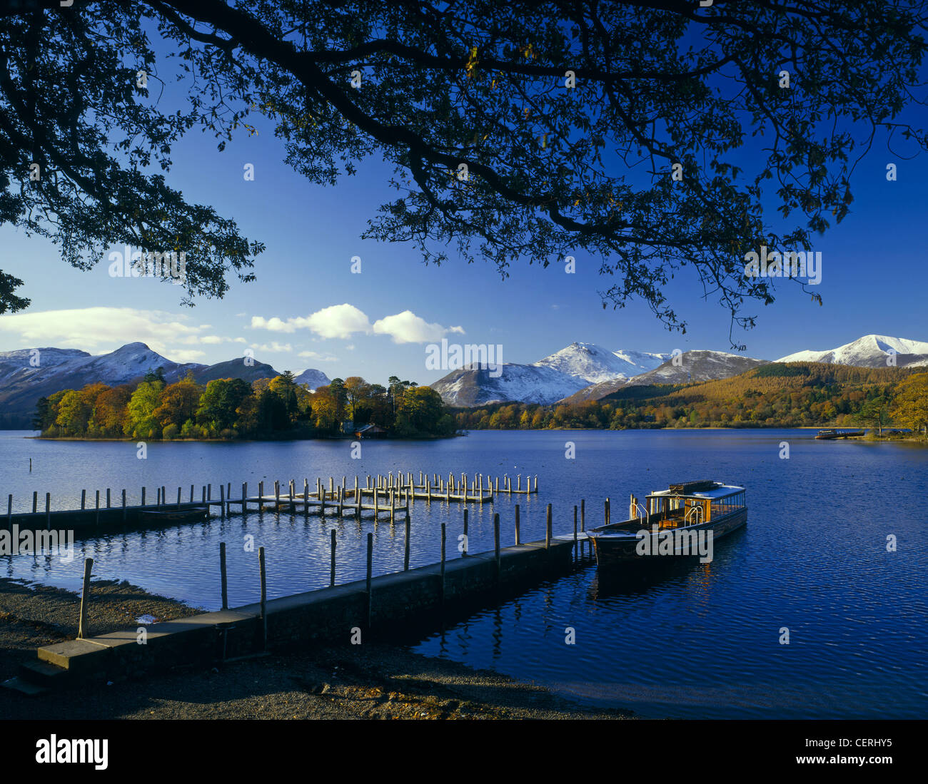 Boat tied to a jetty on Derwent Water at Friar's Crag. Stock Photo
