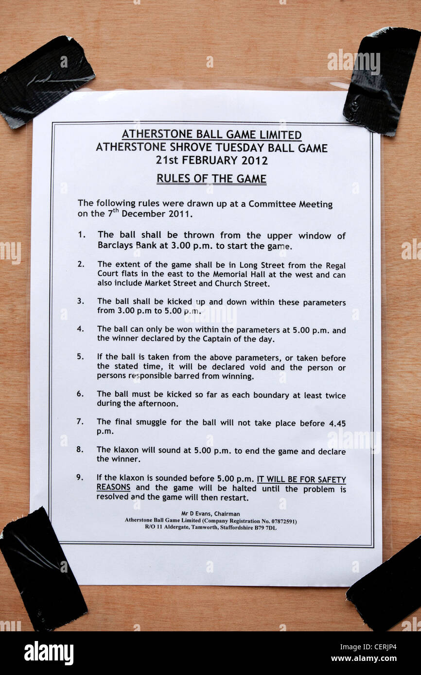 Atherstone ball game 2012, rules of the game taped onto a hoarding in the High Street. - Stock Image