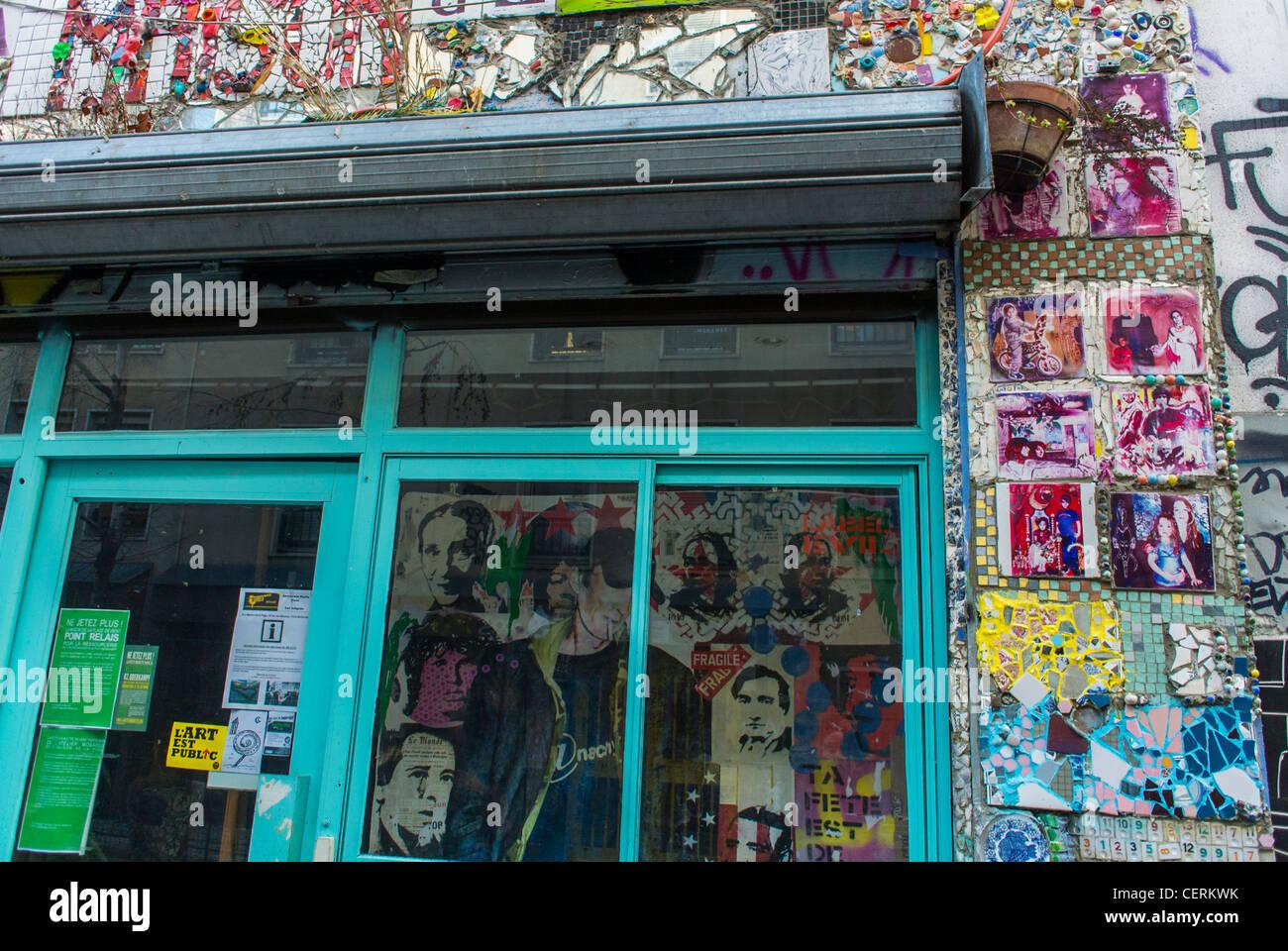 Paris, France, Old Storefront in Belleville District, Graffiti Street Art - Stock Image