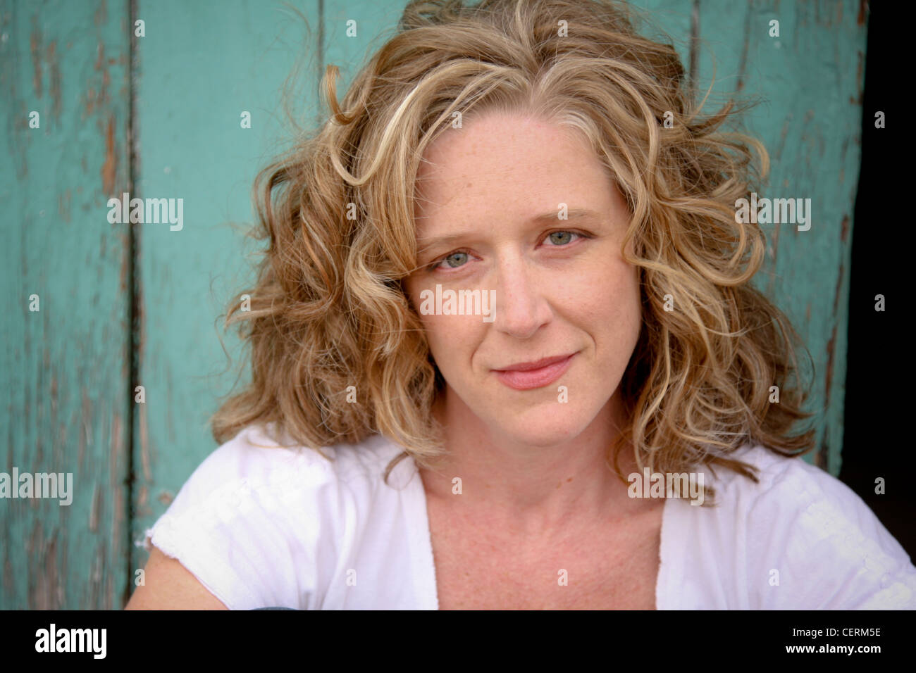 blond woman posing for a headshot - Stock Image