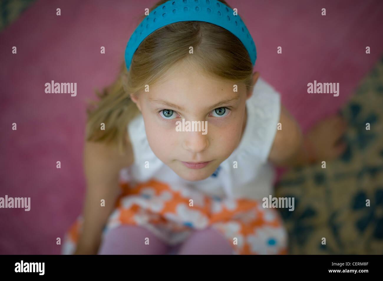 Closeup portrait of a girl wearing a blue headband - Stock Image