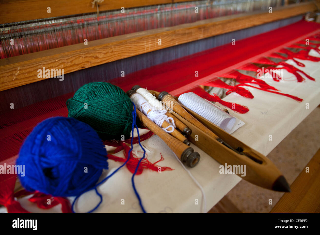 Photograph of an old traditional loom with colorful cotton threads and related tools on it, Zagorohoria, Ioannina, - Stock Image