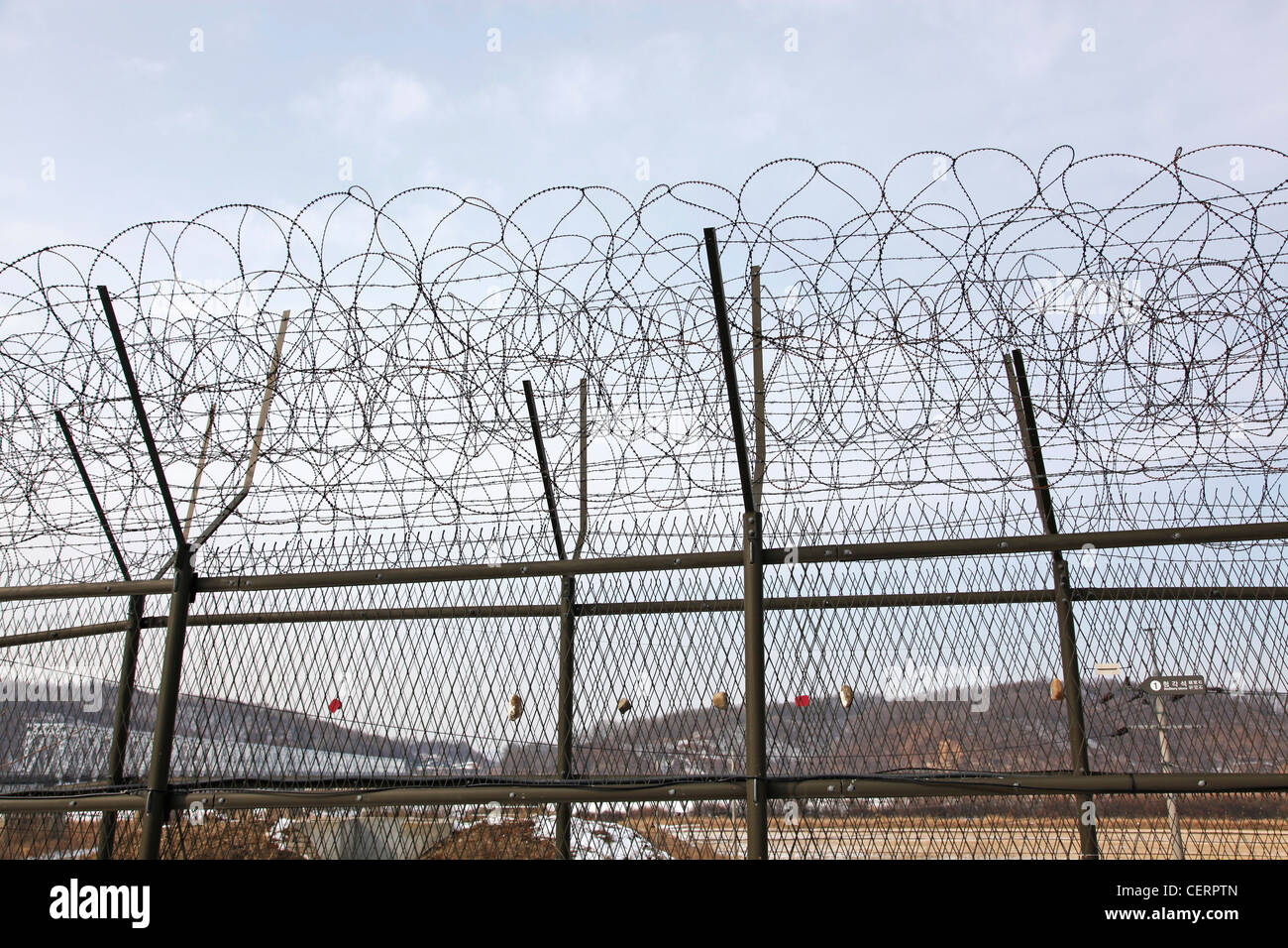 Barbed wire fence and South Korean flag at the DMZ, De-militarised Zone on the South North Korean border, Imjingak, - Stock Image