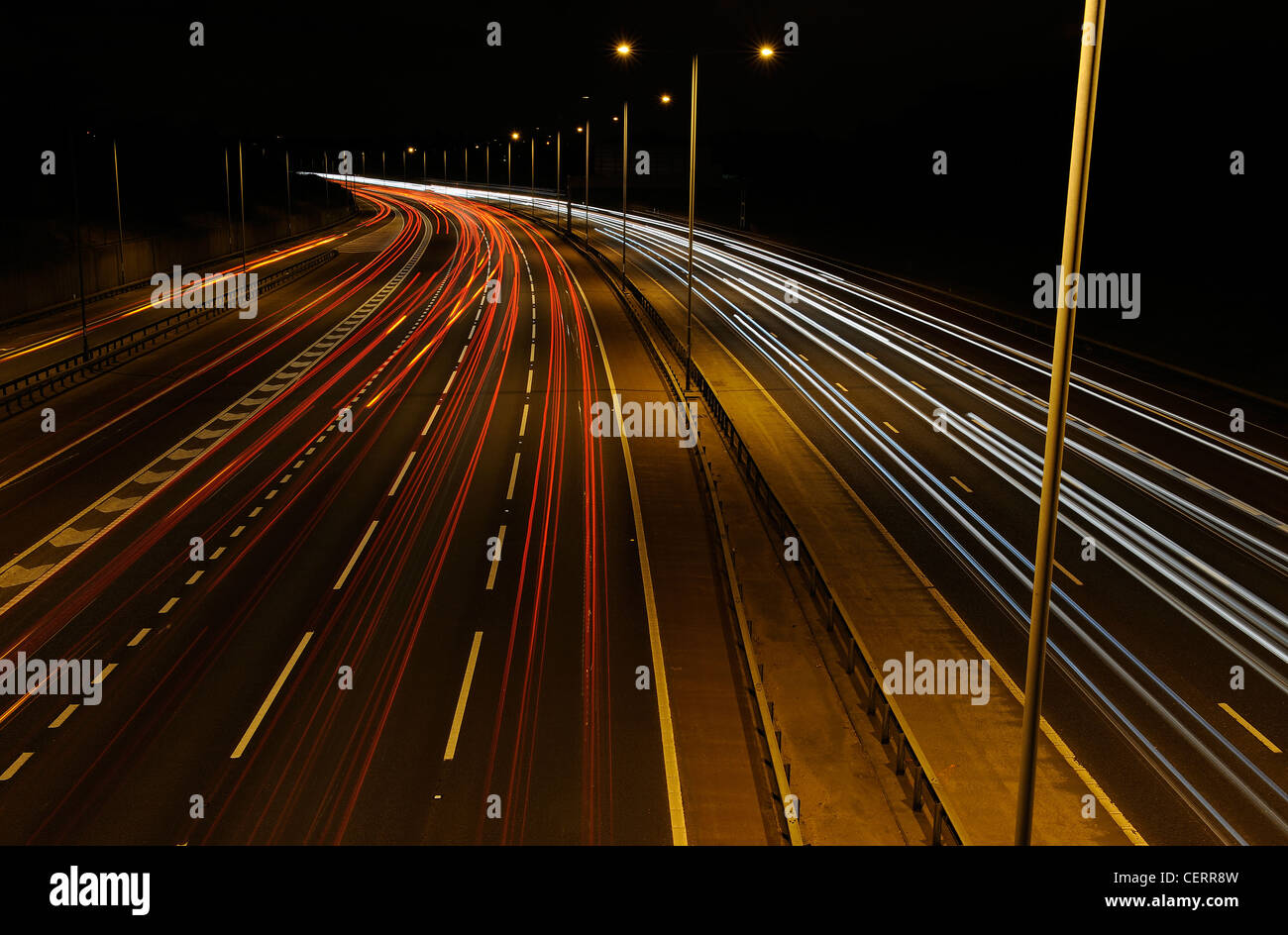 Night view from a bridge of light trails from traffic on the M25 motorway. - Stock Image