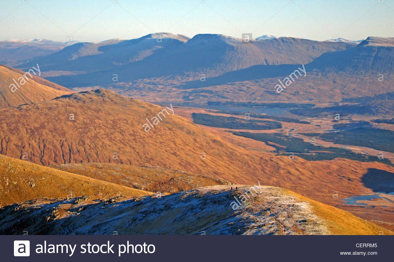 Hill walkers on Glen Etive. - Stock Image