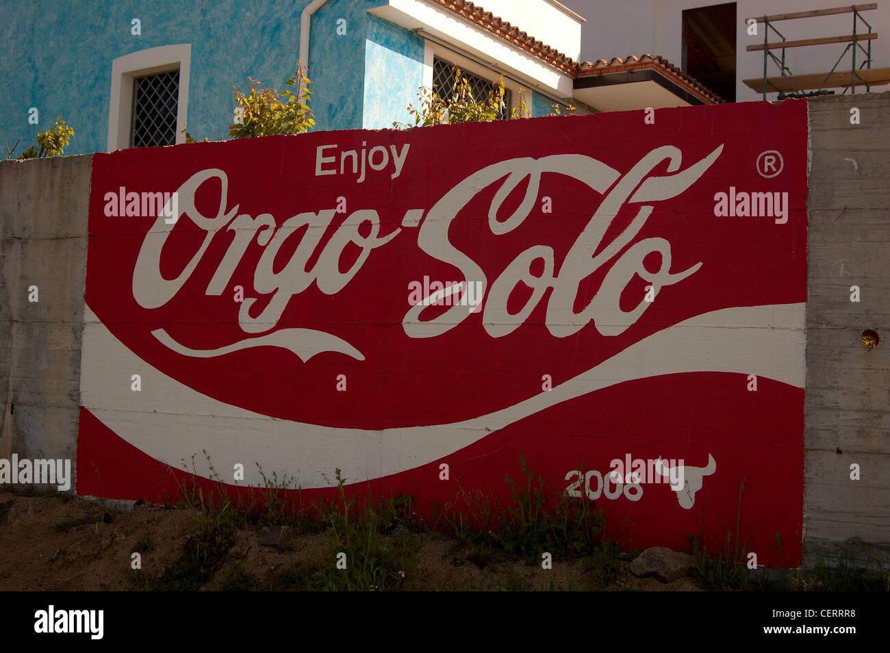 Orgosolo Coca Cola like writing (Sardinia) - Stock Image