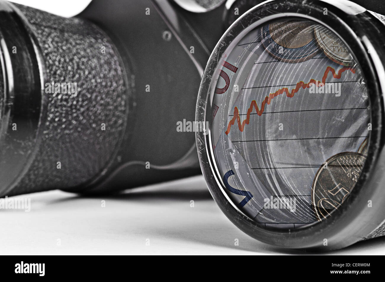 Old Binoculars Seeing Financial Crisis, gritty grainy look. - Stock Image