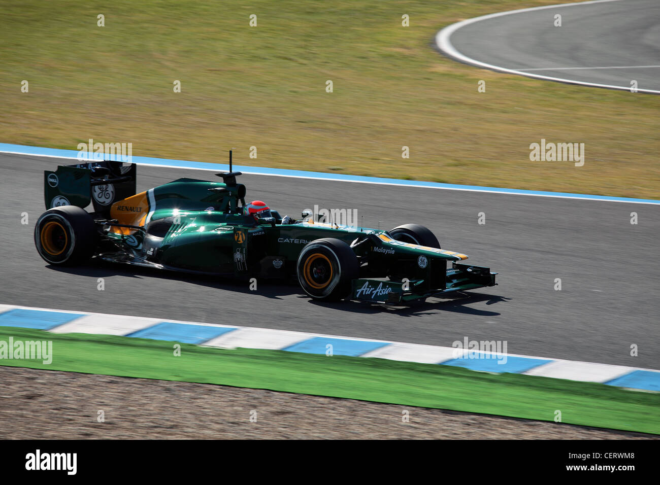 Jarno Trulli driving Caterham Formula one racing car during track testing at Jerez Andalucia Spain - Stock Image