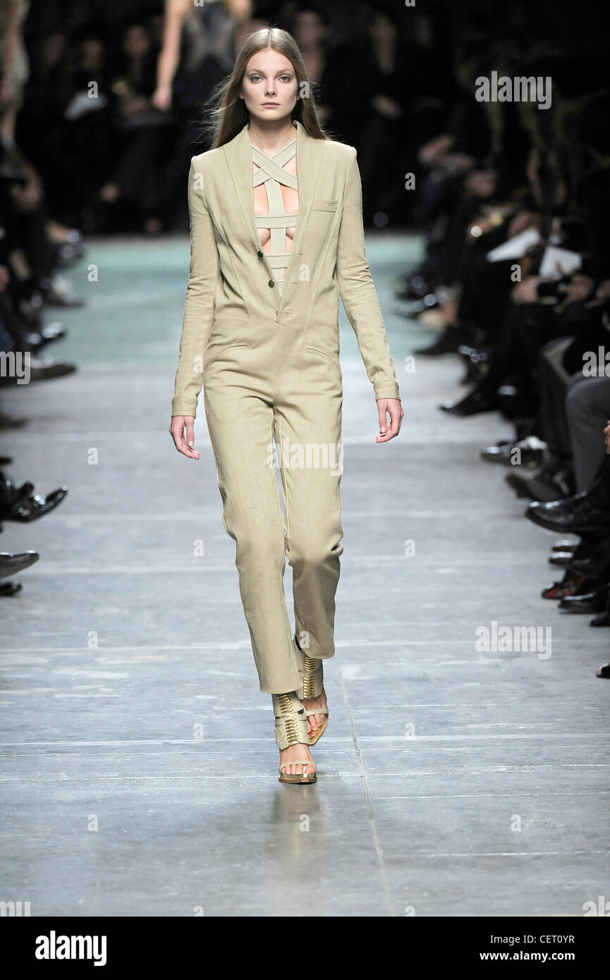 cef41a4d119b Givenchy Paris Ready to Wear Spring Summer Model wearing a khaki beige  jumpsuit a revealing bandage