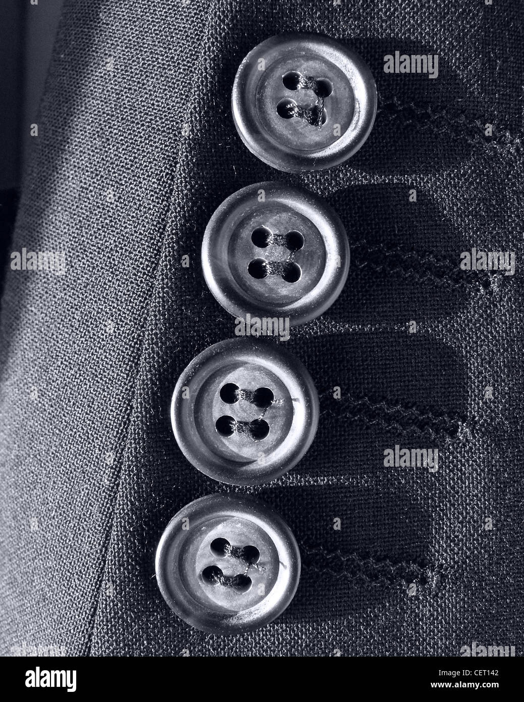 Four buttons on a quality suit Tailor tailoring Stock Photo