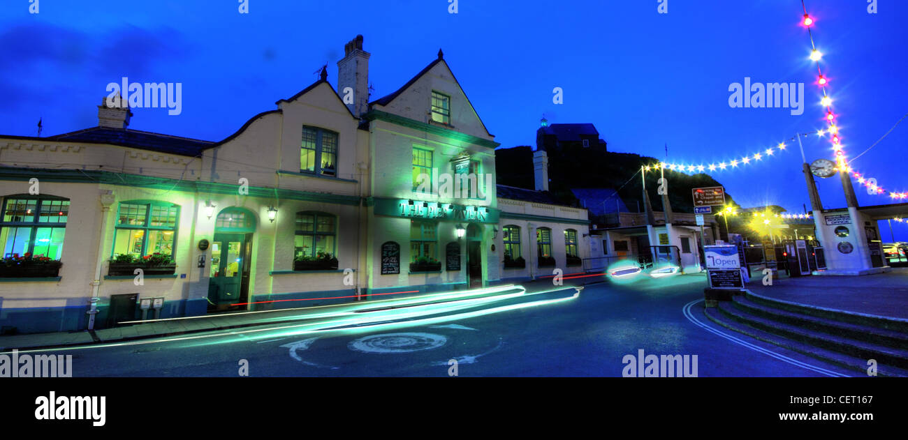Dusk at the Ilfracombe Pier tavern, North Dorset, SW England, UK - Stock Image