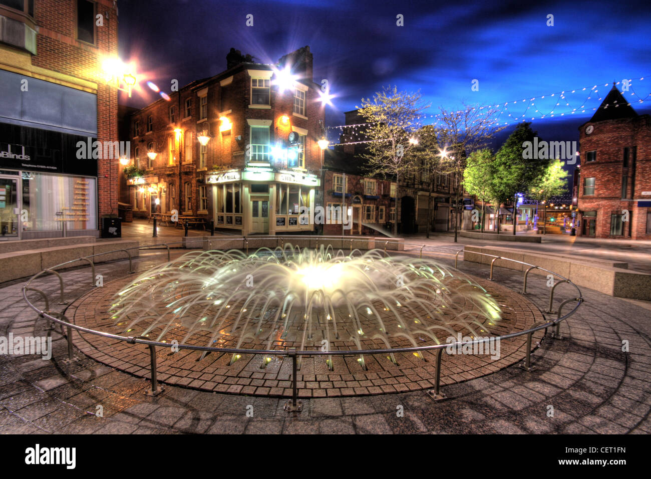 Bridge St / Hatters Row Fountain Opposite The Blue Bell Pub, Horse Market Street, Warrington at dusk, Cheshire, - Stock Image