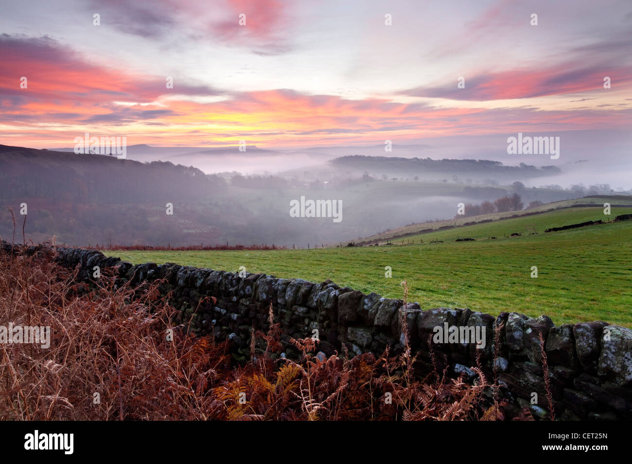 Autumn morning mist over the village of Hathersage in the Peak District National Park. - Stock Image