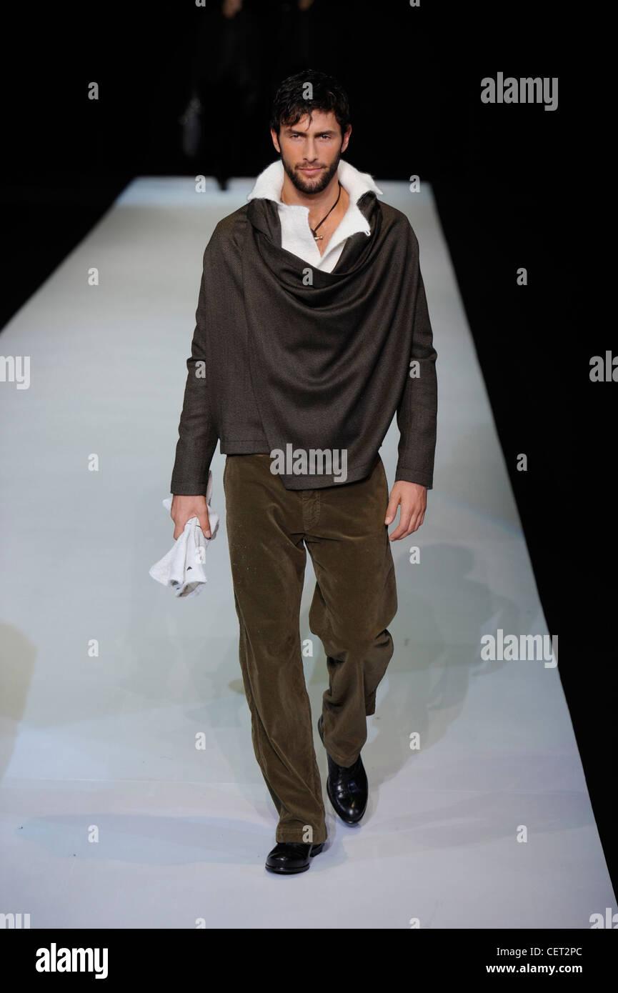 Emporio Armani Milan Menswear Ready to Wear Autumn Winter Dark brown shawl coat, corduroy trousers - Stock Image