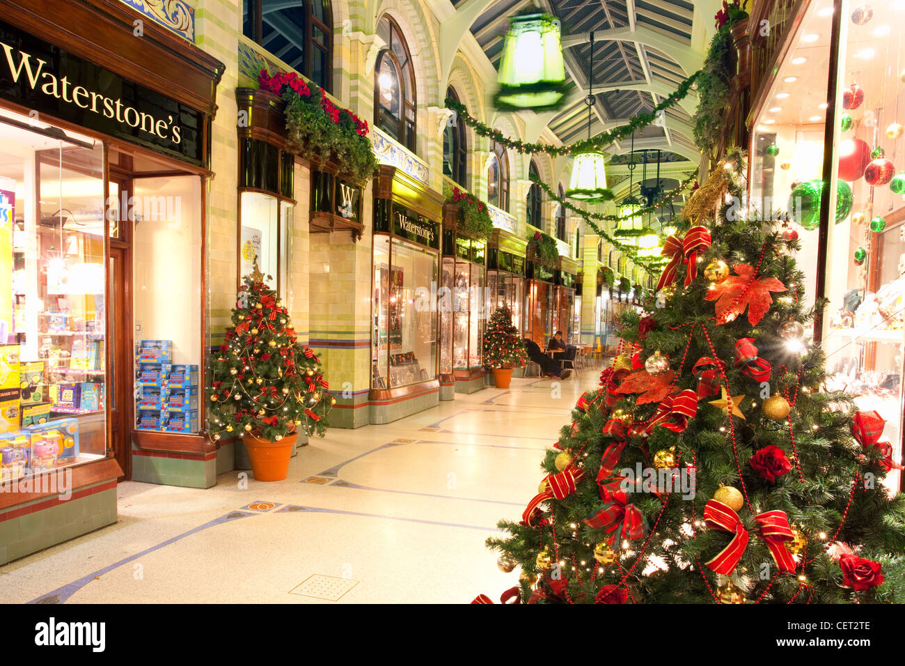 Christmas decorations outside shops in Royal Arcade in Norwich City centre. - Stock Image