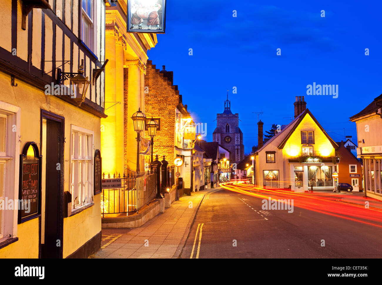Light trails from cars in Diss town centre at dusk. - Stock Image