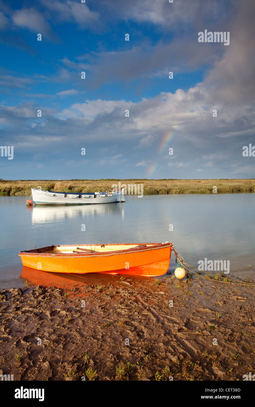 A rainbow over the small fishing harbour at Morston on the North Norfolk Coast. - Stock Image