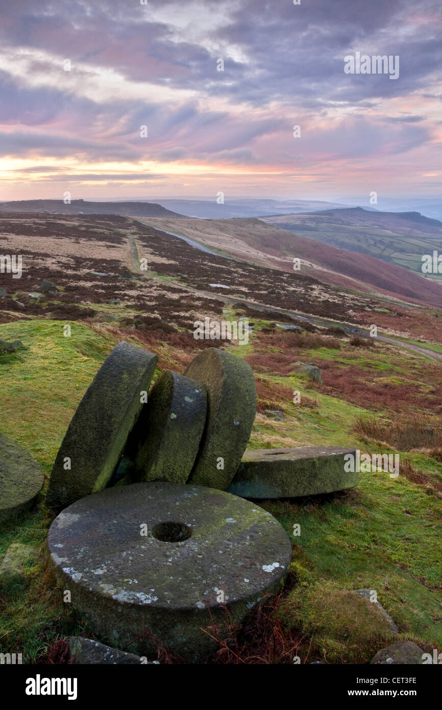 Abandoned millstones beneath Stanage Edge at first light in the Peak District National Park. Stock Photo